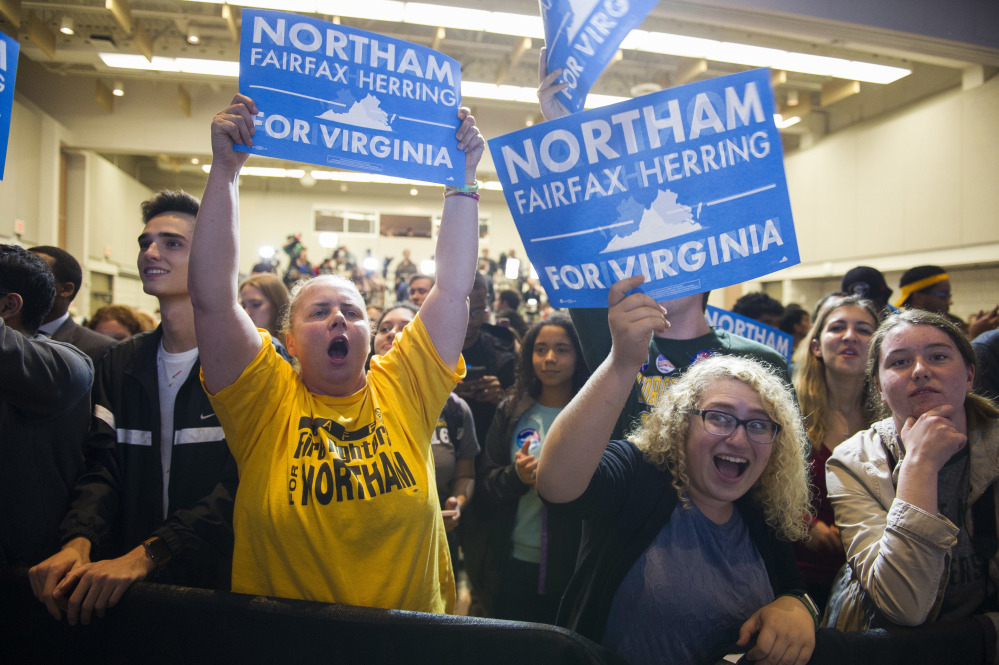 Supporters celebrate Virginia Democrat Ralph Northam's gubernatorial victory at George Mason University in Fairfax, Va., on Tuesday. As they prepare for the 2018 midterms, Democrats will need an agenda and candidates that can inspire the same unwavering devotion that President Trump maintains in his base.