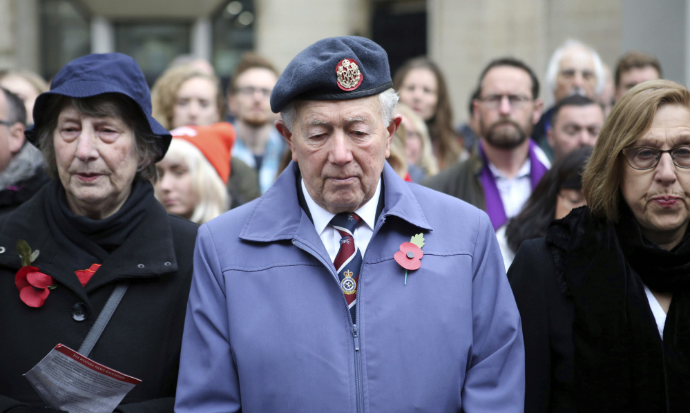 Members of the public observe a two-minute silence during a service of remembrance in London on Saturday.