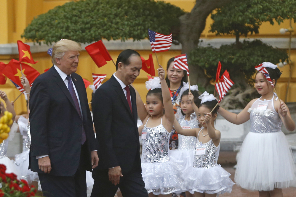 President Trump and Vietnam's President Tran Dai Quang attend the welcoming ceremony at the Presidential Palace in Hanoi, Vietnam, on Sunday.