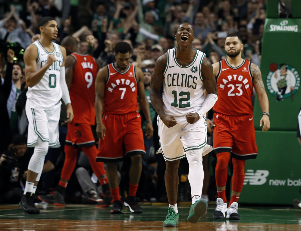 Celtics guard Terry Rozier celebrates after Boston extended its winning streak to 12 games with a 95-94 win Sunday afternoon against the Toronto Raptors.