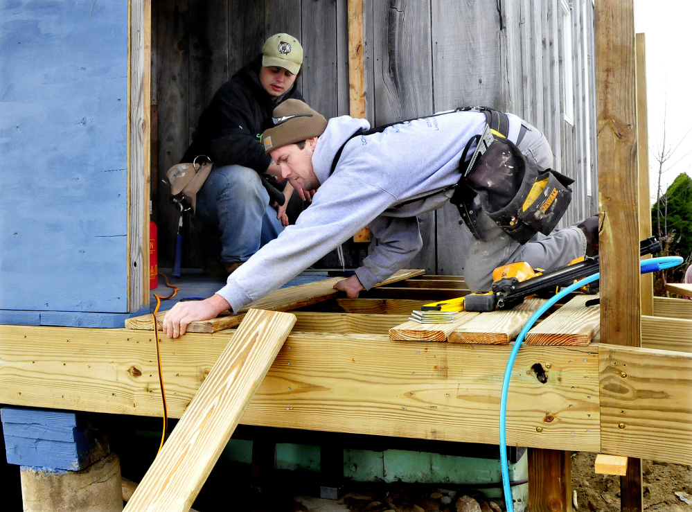 Sam Cantlin, front, and Joe Taylor work on a wheelchair ramp at the Palermo Community Center on Sunday.