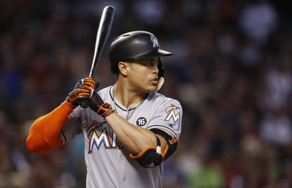 Signed to a pricy long-term contract with an opt-out clause,  Giancarlo Stanton would have to waive his no-trade status before the Red Sox or another team could acquire him.