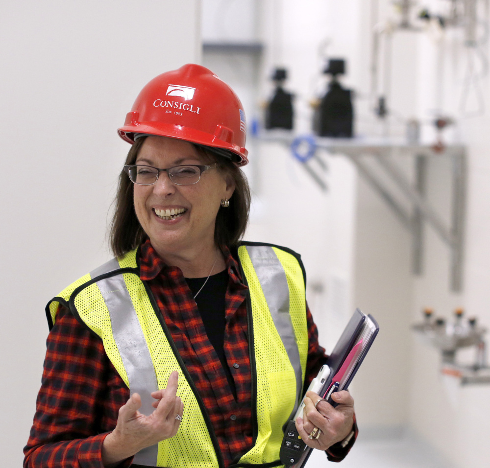 Betsy Williams, vice president of manufacturing operations at ImmuCell, gives a tour of the company's new facility in the Riverside area of Portland recently.