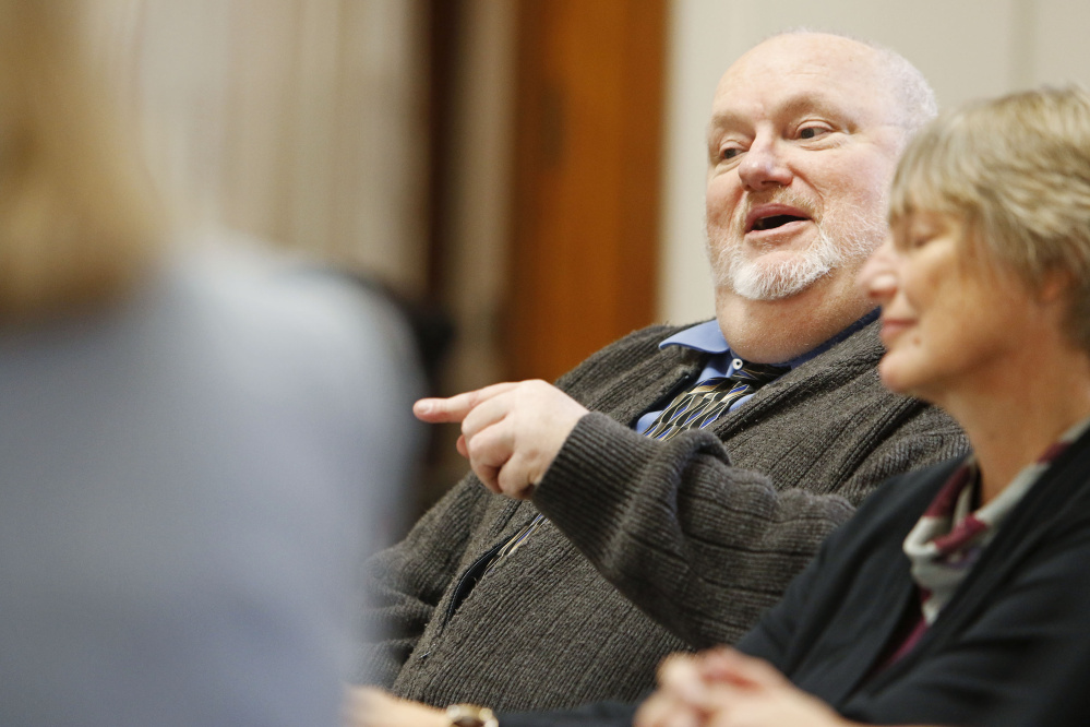 Bob Wellington,  a representative of Agri-Mark Dairy Cooperative, discusses the effects on agricultural cooperatives in Maine during a round table meeting with U.S. Rep. Chellie Pingree at Portland City Hall regarding the Republican tax plan on Monday.