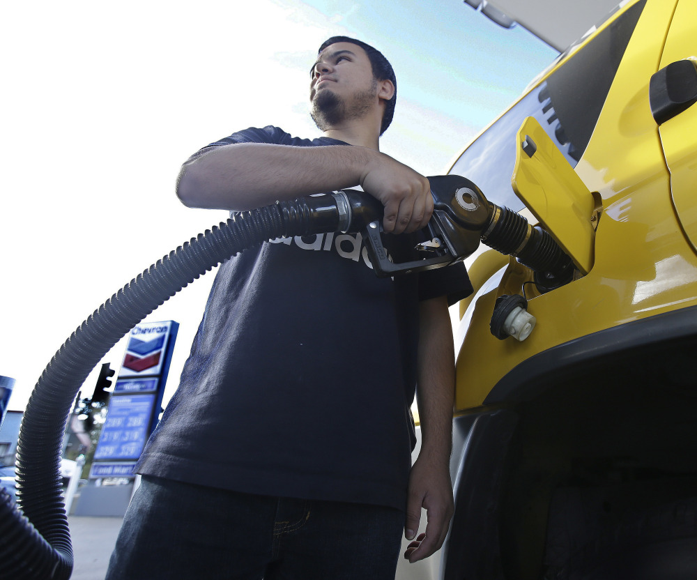 Cristian Rodriguez fuels his vehicle Oct. 30 in Sacramento, Calif. A more widespread use of electric cars will not be enough to consign oil to the past, the IEA director says.