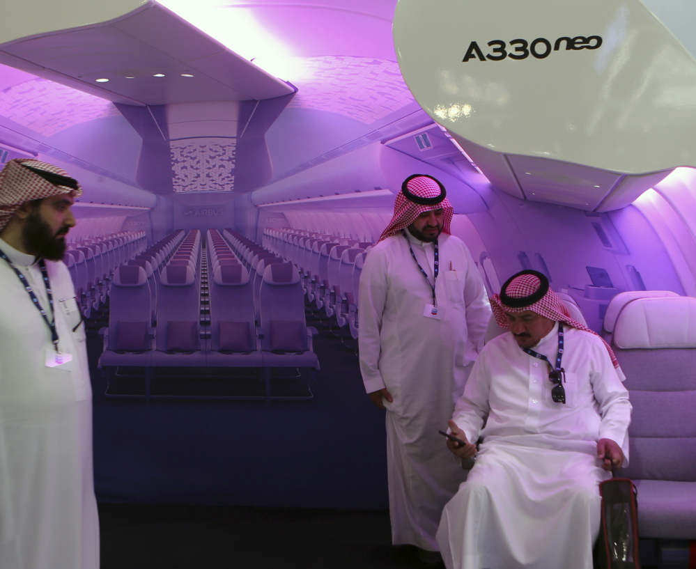 An Airbus wide-body mockup garners attention at a biennial air show Wednesday in Dubai, where members of the aerospace industry completed significant transactions.