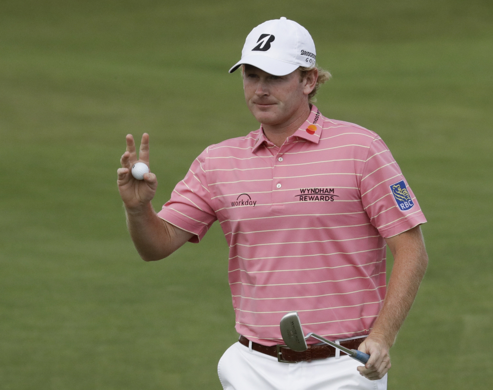 Brandt Snedeker waves after putting on the 12th hole during the fourth round of the U.S. Open in June. Snedeker hasn't played since withdrawing from the British Open in July.