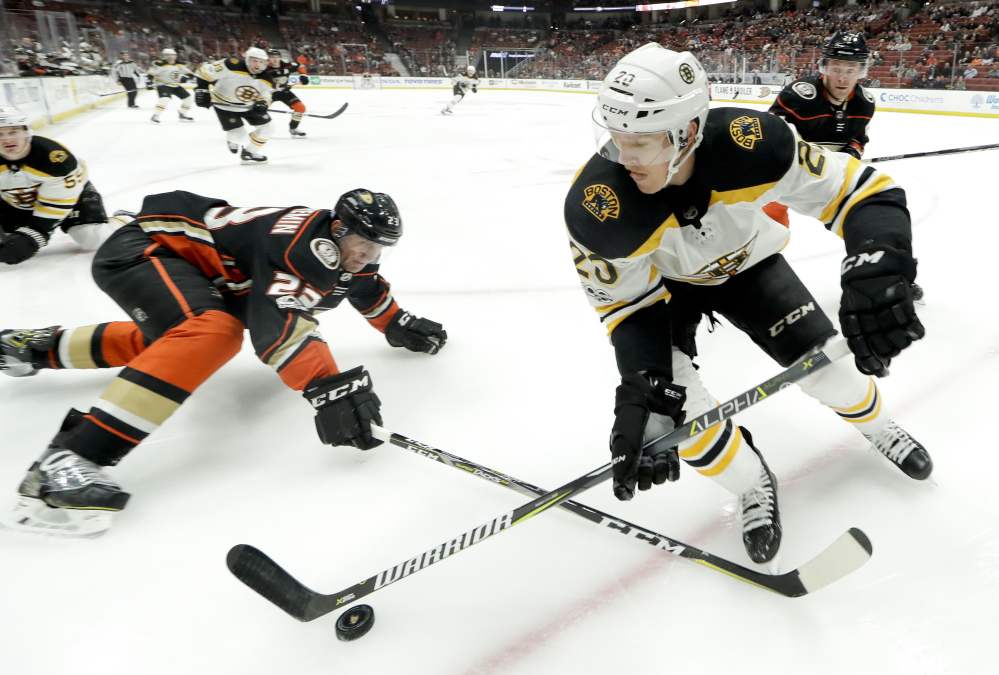 Boston's Riley Nash battles for the puck with Anaheim defenseman Francois Beauchemin in the first period Wednesday night in Anaheim, Calif.