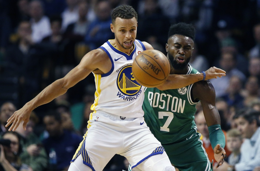 Boston's Jaylen Brown and Golden State's Stephen Curry battle for a loose ball during the first quarter of Thursday night's game in Boston. The Celtics won 92-88.