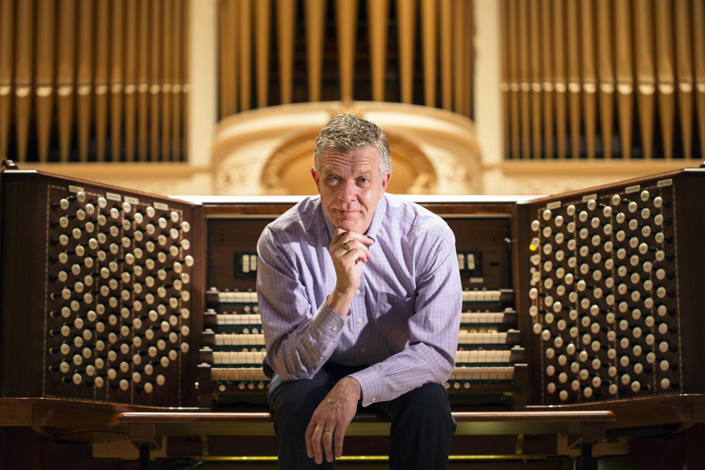 Municipal organist Ray Cornils at the Kotzschmar Organ at Merrill Auditorium in Portland. Cornils plans to retire at the end of this year.