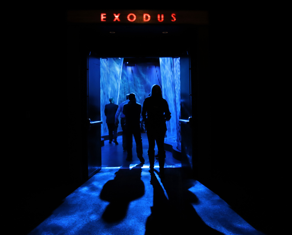 """A door opens to the """"Exodus"""" section inside the Museum of the Bible in Washington. The project is largely funded by the conservative Christian owners of the Hobby Lobby crafts chain. Hobby Lobby president Steve Green, left, says the aim is to educate, not evangelize. But skeptics call the project a Christian ministry disguised as a museum. Associated Press/Jacquelyn Martin"""