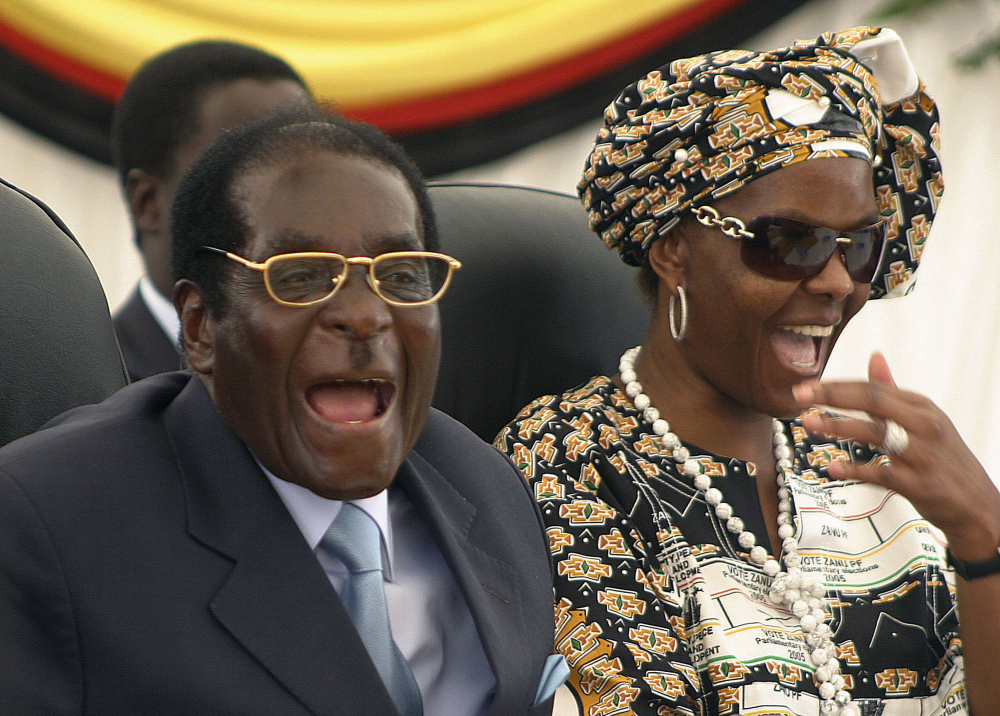 President Robert Mugabe, shown with his wife, Grace, is believed to be staying at his Harare compound. Grace Mugabe's presidential ambitions alarmed many Zimbabweans.