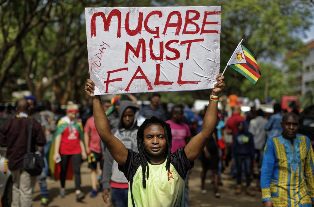 Protesters demanding that longtime President Robert Mugabe stand down march toward the State House in Harare, Zimbabwe, on Saturday.