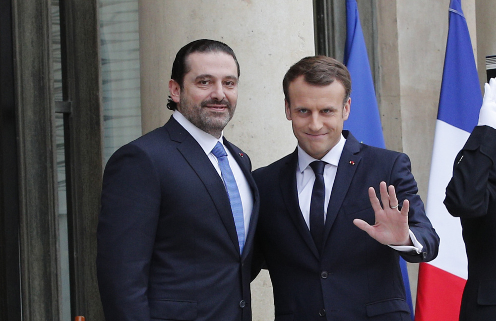 French President Emmanuel Macron, right, greets Lebanon's Prime Minister Saad Hariri in Paris on Saturday. Hariri wants to dispel fears that he had been detained in Saudi Arabia.