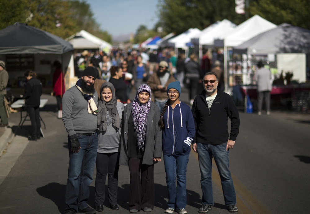 From left, Mustafa Azimi, wife Zarifa Azizi, Sureyya Hussain, Reema Iqbal and Radwan Jallad stand for a photo during the downtown farmers market in Las Cruces, N.M.