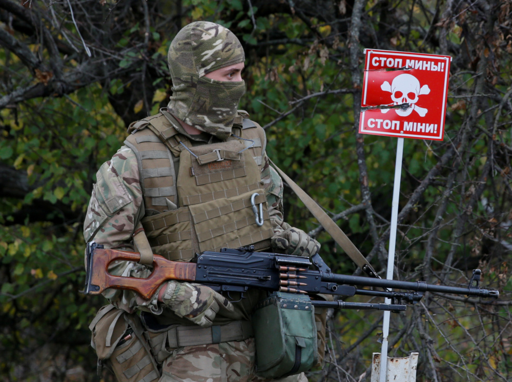 A mine warning is displayed at a checkpoint on the contact line between pro-Moscow rebels and Ukrainian troops.