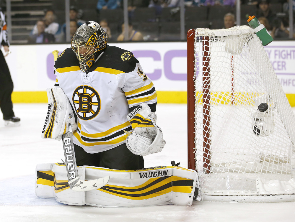 Bruins goalie Anton Khudobin stops a shot by the San Jose Sharks during the second period Saturday night in San Jose, Calif. Boston won the game, 3-1.