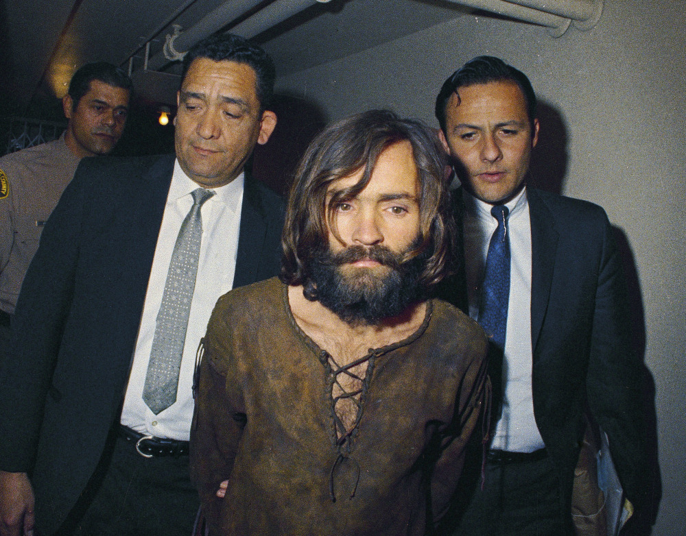 In this 1969 file photo, Charles Manson is escorted to his arraignment on conspiracy and murder charges in connection with the Sharon Tate murder case.