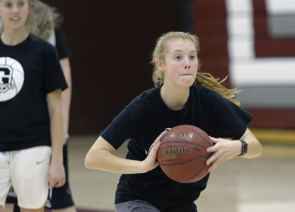 Anna DeWolfe, a two-time All-State player and one of two returning starters for Greely, makes a pass during her team's opening practice Monday.