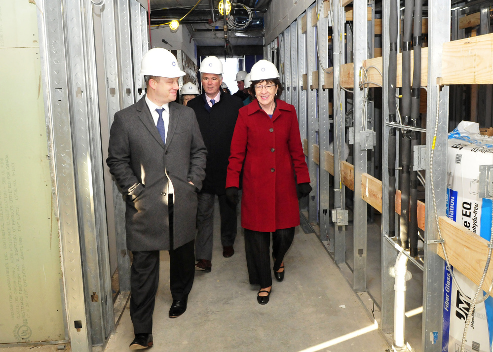 U.S. Sen. Susan Collins, R-Maine, Colby College President David Greene, center, and Brian Clark, Colby's vice president of planning, tour Colby's unfinished multi-purpose residential building Monday in downtown Waterville.