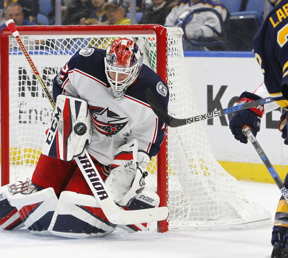 Columbus goaltender Sergei Bobrovsky wards off a shot with his blocker during the first period of the Blue Jackets' 3-2 win over the Sabres on Monday in Buffalo.