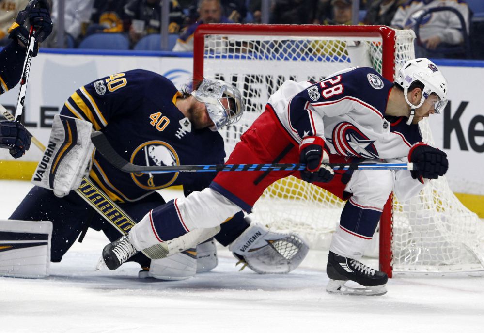 Buffalo Sabres goalie Robin Lehner and Columbus Blue Jackets forward Oliver Hannikainen collide in the crease during the second period of Monday's game, won by Columbus 3-2.