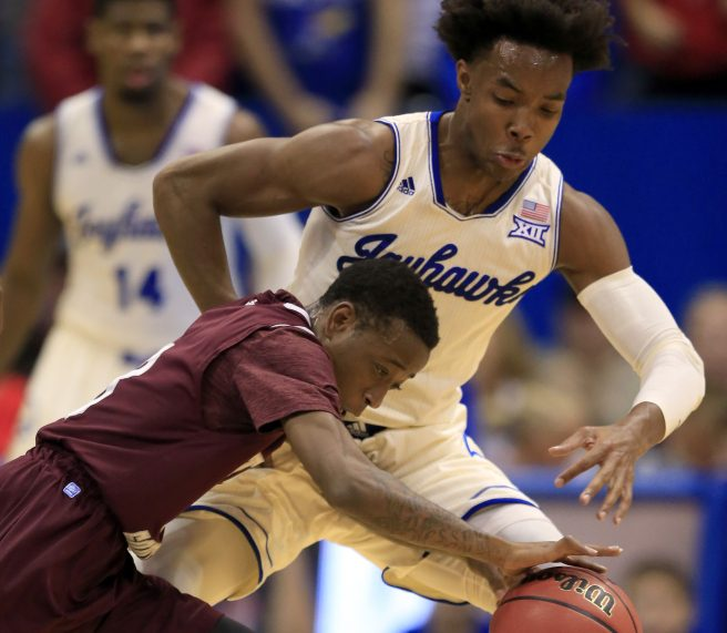 Demontrae Jefferson of Texas Southern attempts to get around Devonte' Graham of Kansas during the first half of Kansas' 114-71 victory Tuesday night.