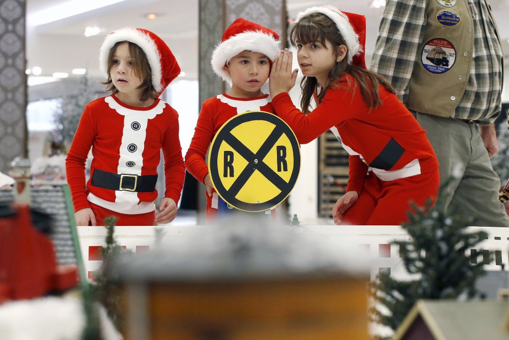 Jackson Garcia, 6, center, is flanked by his cousins Emma Bennett, 6, left, and her sister Elizabeth Bennett on Wednesday as they survey a sprawling series of model train sets at the Winter Wonderland at the Maine Mall. Retailers are gearing for the heavily hyped Black Friday this week, but it isn't actually the busiest shopping day of the holiday season.