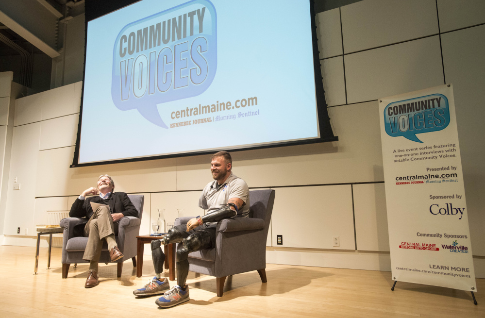 Portland Press Herald columnist Bill Nemitz interviews retired Army Staff Sgt. Travis Mills on Tuesday evening during a Community Voices event at Ostrove Auditorium at the Diamond Building at Colby College in Waterville.
