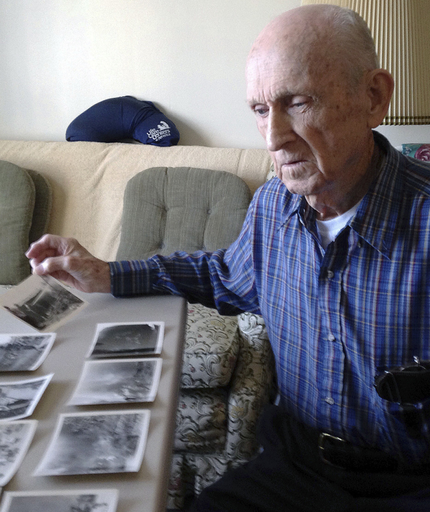 Kenneth F. Lincoln, 90, with photos taken when he was in the U.S. Navy and fighting a large fire in Rabat, Morocco, in 1946.