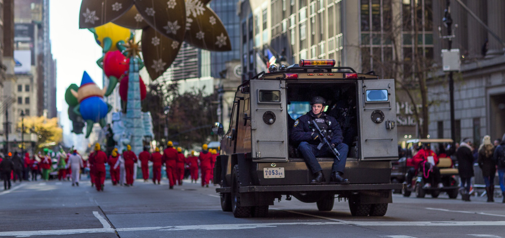 Heavily armed police patrol the parade route during the Thanksgiving Day parade in New York on Thursday.
