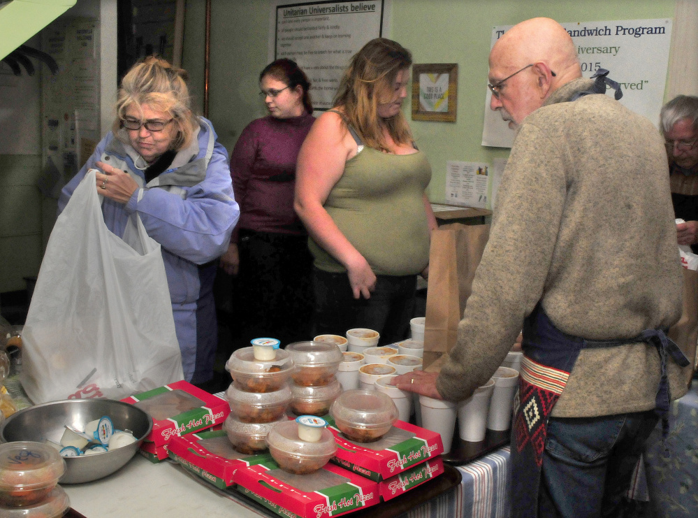 Volunteer Bruce O'Donnell serves at the Evening Sandwich program at the Unitarian Universalist Church in Waterville on Tuesday. It is among the organizations benefiting from the new Food Recovery Program.
