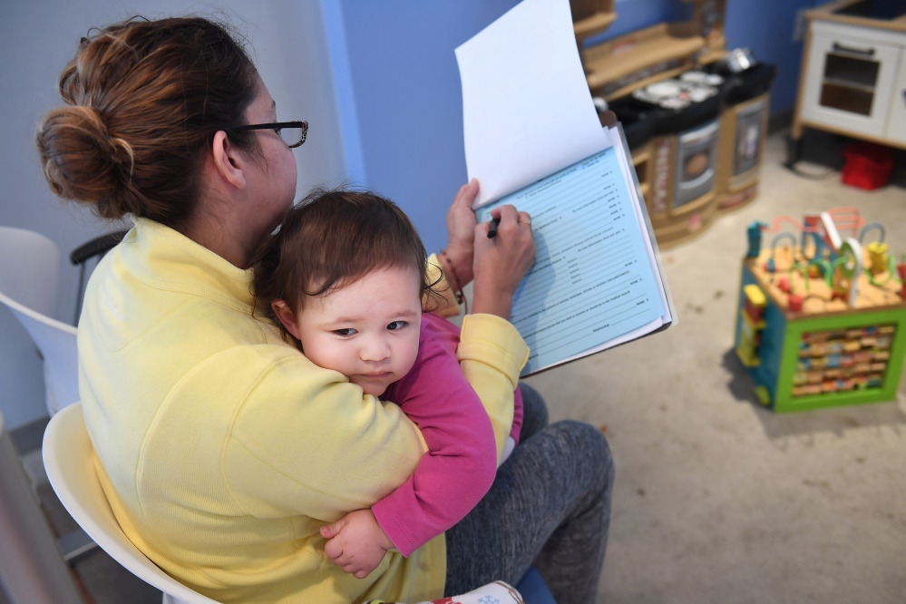 Marbell Castillo, who takes her granddaughter Maia to her doctor appointments because her daughter works two jobs, worries about the little girl's health care if CHIP isn't funded.