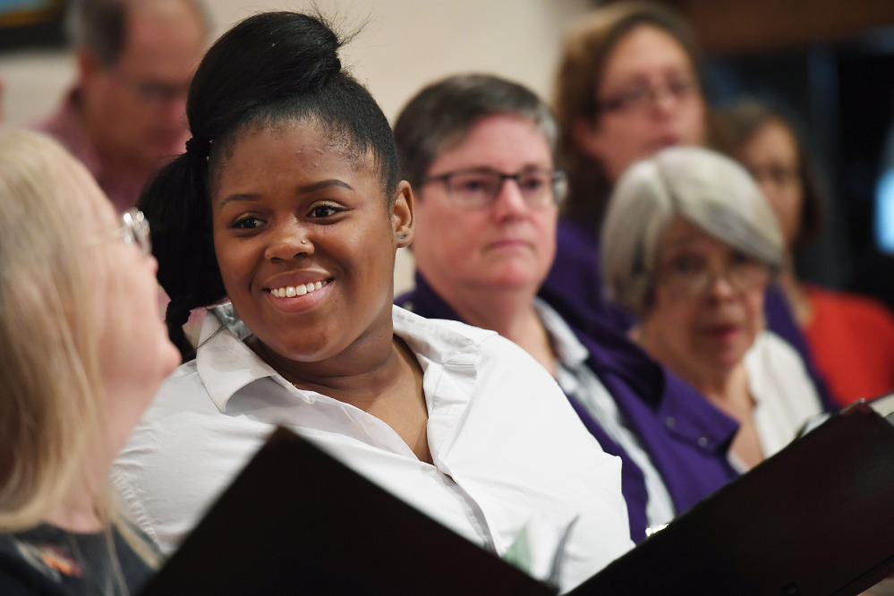 Pamela Perry, left, and Patrice Eubanks talk during a St. Margaret's choir rehearsal. The church has seen attendance rise this year.
