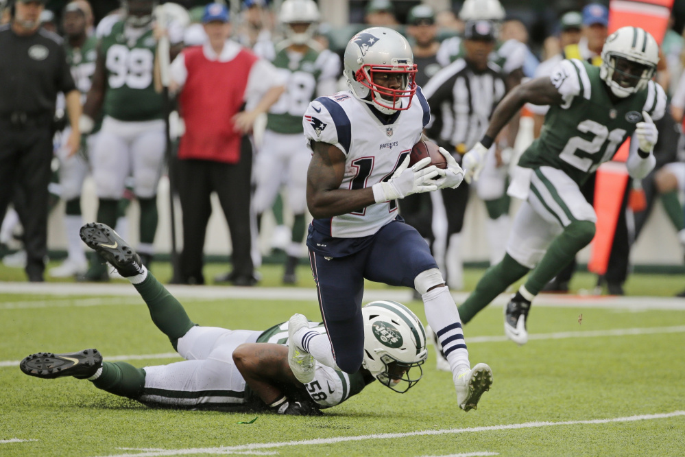 Patriots receiver Brandin Cooks breaks a tackle by Darron Lee of the New York Jets on Oct. 15. Cooks has been a great fit with New England and hopes it will be a long-term one.
