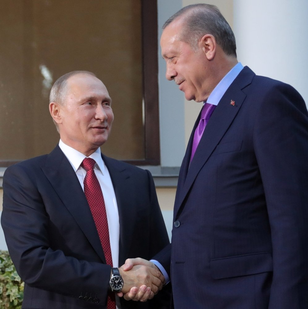 Russian President Vladimir Putin, left, and Turkish President Recep Tayyip Erdogan meet at the start of talks Tuesday in Russia. Erdogan has opposed the U.S. arming of Syrian Kurds to fight the Islamic State.