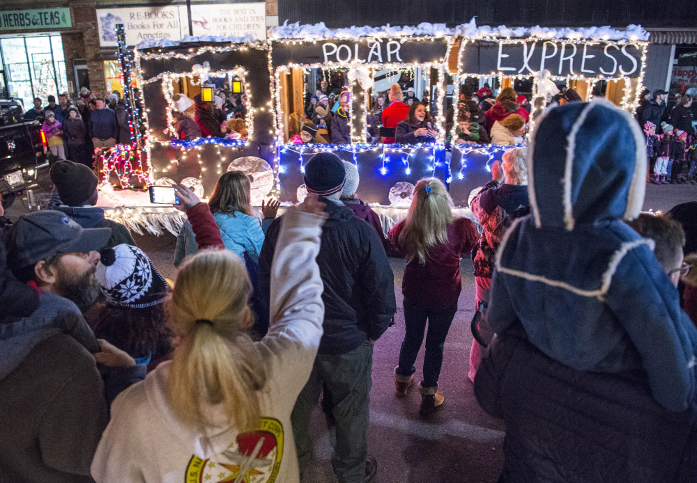 The annual Parade of Lights marches down Main Street on Friday in downtown Waterville.