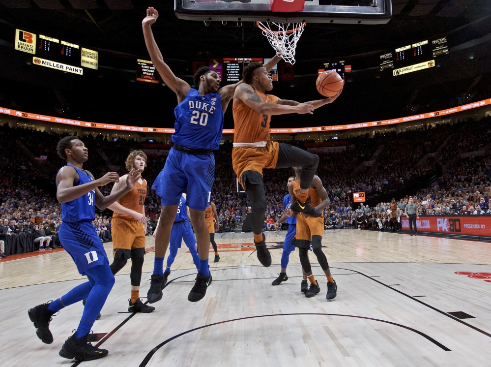 Texas guard Jacob Young goes up for a shot with Duke center Marques Bolden defending during their semifinal in the PK80 Invitational tournament in Portland, Ore. Duke overcame a 16-point deficit to win 85-78 in overtime.
