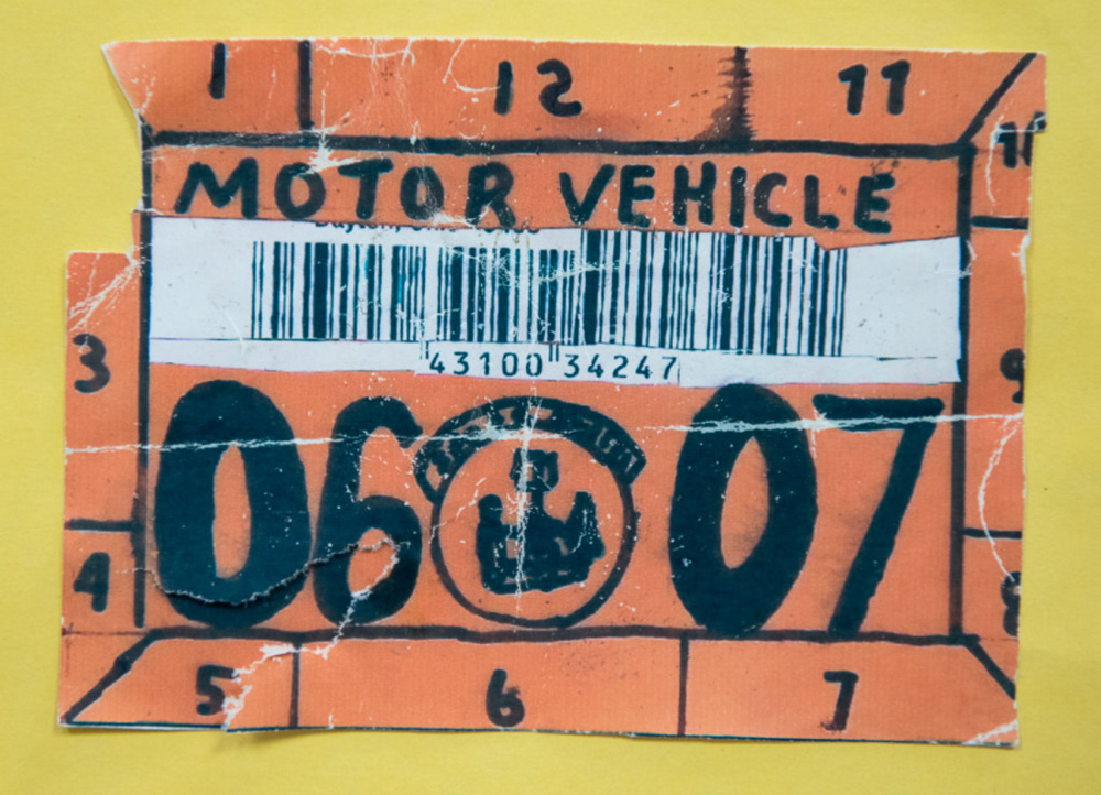 One of the confiscated counterfeit inspection stickers that are displayed on the fake sticker hall of fame board in the traffic safety unit headquarters in