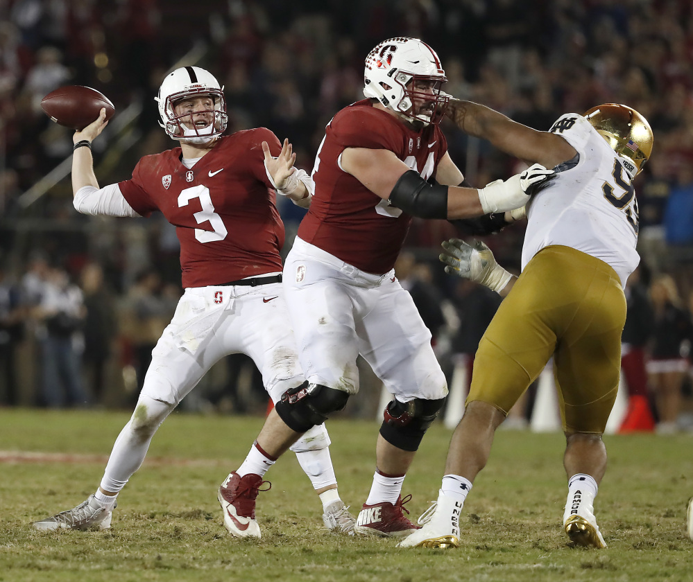Stanford quarterback K.J. Costello throws a pass against Notre Dame during the second half Saturday night in Stanford, Calif. Stanford won 38-20.