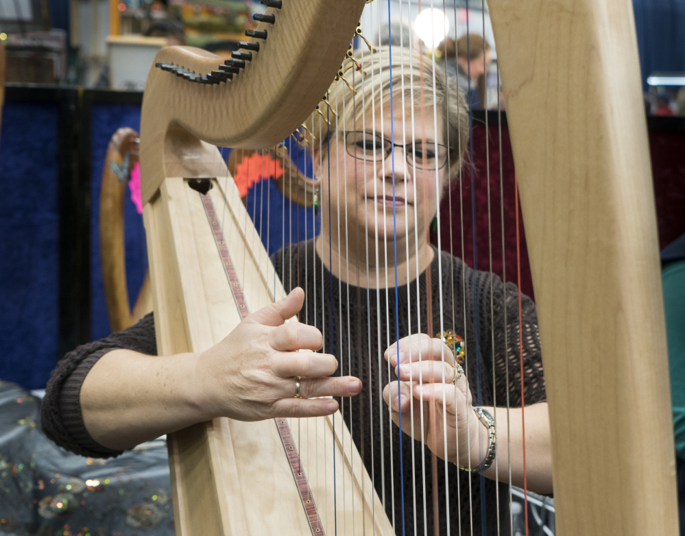 Mellori Worthen of Mercer plays the harp at the Maine Made Crafts Show at the Augusta Civic Center on Sunday.