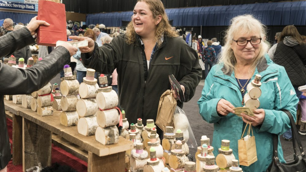 Wendy Struck, left, of Livermore Falls shops with her mother, Brenda, of Readfield at the Misfit Snowman booth.