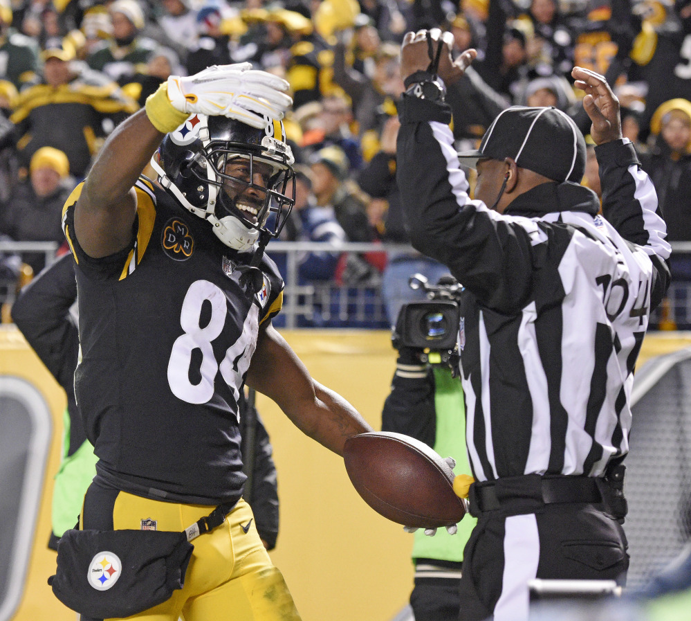 Pittsburgh wide receiver Antonio Brown celebrates his touchdown catch in front of field judge Dale Shaw during the second half against the Green Bay Packers in Pittsburgh on Sunday night. The Steelers won, 31-28.