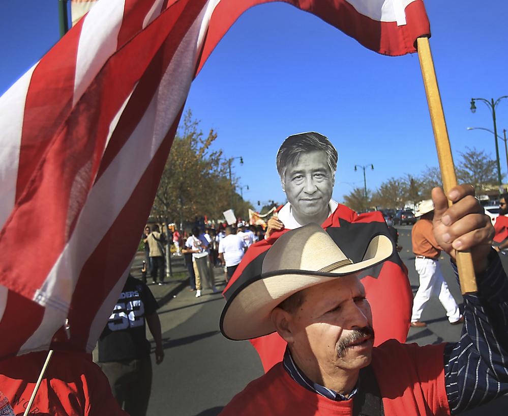 United Farm Workers supporters rally in Santa Rosa in April at the annual march for Cesar Chavez, pictured at center, the iconic labor leader who launched the farmworker union.