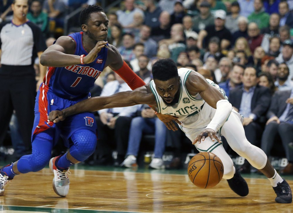 The Pistons' Reggie Jackson fouls Boston's Jaylen Brown on a play in the second quarter of Monday night's game in Boston.
