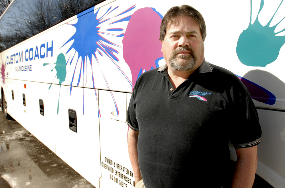 Gregg Isherwood, seen in 2008, says his bus company, Custom Coach and Limousine, and others did not get a chance to bid on a USM student shuttle before the Metro public service was chosen.