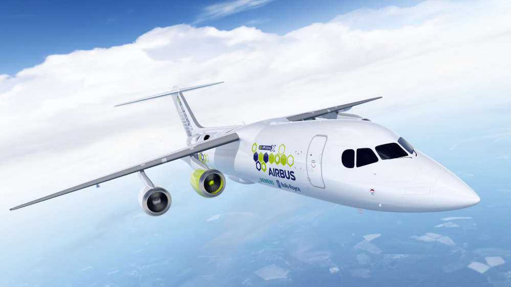 The artist rendering provided by Airbus on Tuesday shows an Airbus e-FanX hybrid test plane. The aircraft will fly with one electric turbofan motor and three conventional engines. The power for the electric engine is produced by a turbine within the plane that serves as a generator.
