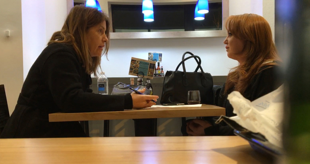 Washington Post reporter Stephanie McCrummen, left, questions a woman who appeared to be trying to trick the newspaper into publishing a story based on a false charge.