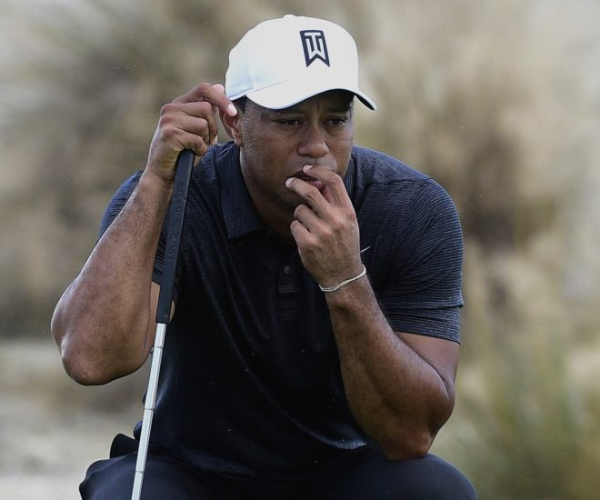 Tiger Woods prepares for a shot Thursday during the first round of the Hero World Challenge in Nassau, Bahamas. Woods, in his first competitive round since February, shot a 3-under 69.