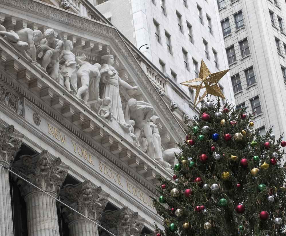 A golden star tops the Christmas tree outside the New York Stock Exchange on Wall Street on Thursday.